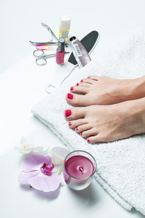 beautiful female feet pedicure tool orchid